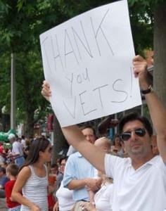 Genesis10 CEO Harley Lippman thanking veterans at a Memorial Day parade.
